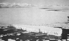 "An iceberg being pushed out of a shipping lane USS Burton Island (AGB-1), USS Atka (AGB-3), and USS Glacier (AGB-4) pushing an iceberg out of a channel in the ""Silent Land"" near McMurdo Station, Antarctica, 1965"