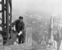 A construction worker atop the Empire State Building as it was being built in 1930; to the right is the Chrysler Building.