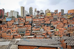 Favela of Paraisópolis, in the district of Vila Andrade, with residential buildings in the background.
