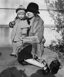 Alice Roosevelt Longworth on her 43rd birthday in 1927 with her daughter Paulina, age 2