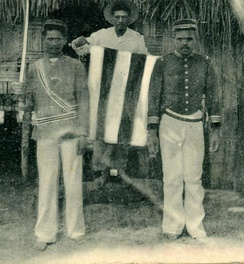 Indigenous officers holding the independent flag of Raiatea at Avera, c. 1895