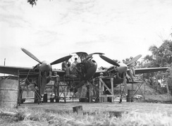 "Ground crew members of the 459th Fighter Squadron, nicknamed the ""Twin Dragon Squadron"", working on a Lockheed P-38 at an air base in Chittagong, India – January 1945"