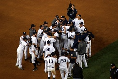 New York Yankees celebrate after their 5–2 win against the Los Angeles Angels of Anaheim.