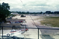 North American P-51s of the 360th Fighter Squadron in protective revetments at Martlesham Heath, 1944.
