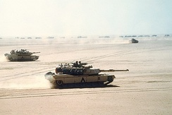 M1 Abrams move out before the Battle of Al Busayyah during the Gulf War