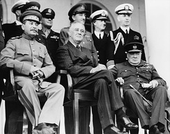 Tehran, Iran, Dec. 1943—Front row: Marshal Stalin, President Roosevelt, Prime Minister Churchill on the portico of the Russian Embassy—Back row: General H.H. Arnold, Chief of the U.S. Army Air Force; General Alan Brooke, Chief of the Imperial General Staff; Admiral Cunningham, First Sea Lord; Admiral William Leahy, Chief of staff to President Roosevelt, during the Tehran Conference