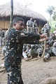 Philippine Army Staff Sgt. Manolo Martin demonstrates the proper way to hold a king cobra during survival course training.