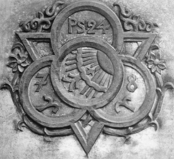 The original C. Bertelsmann Verlag company logo as it appears on Carl Bertelsmann's tomb in Gütersloh.