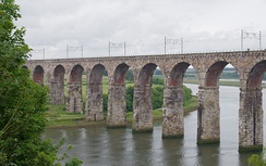 The Royal Border Bridge in England, a protected monument. Adding electric catenary to older structures may be an expensive cost of electrification projects