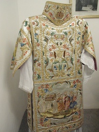 Ornately embroidered dalmatic (shown from the back with an appareled amice)