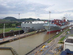 Commercial ships register in Central American states to avoid scrutiny from foreign countries. Pictured: a large carrier ship docking in Panama.