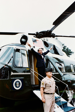 Nixon displays the V-for-victory sign as he departs the White House after resigning, August 9, 1974