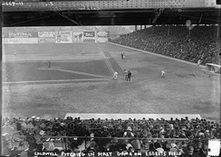 Ray Caldwell pitching in the first exhibition game at Ebbets Field, April 5, 1913. The dirt walkway visible between the mound and the plate disappeared after the 1910s.[7]