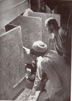 Howard Carter and associates opening the shrine doors in the burial chamber (1924 reconstruction of the 1923 event)