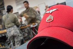 U.S. Army Parachute Rigger's distinctive headgear with Parachute Rigger Badge and rank insignia
