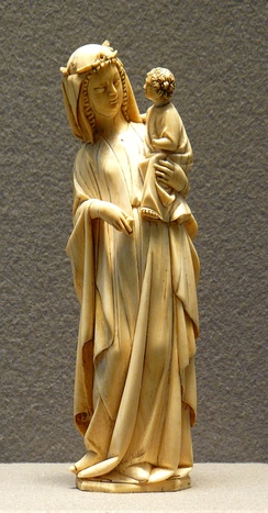 French ivory Virgin and Child, end of the 13th century, 25 cm high, curving to fit the shape of the ivory tusk.