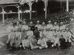 "Charles ""Old Hoss"" Radbourn (standing, far left) giving the finger to the cameraman, the first known photograph of the gesture (1886)[1]"