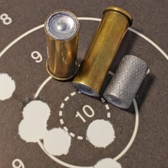 .38 Special wadcutters loaded cartridges and 148 grain hollow-base wadcutter bullet, used for target shooting.