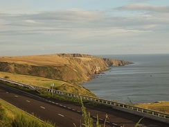 A single carriageway section of the A1 skirting the Scottish coastline just across the border from Northumberland.