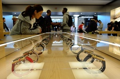 An Apple Store showcase with various Apple Watch models