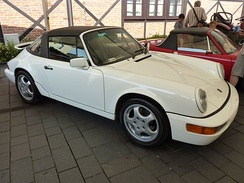 Porsche 911 (964), introduced in 1989, was the first to be offered with Porsche's Tiptronic transmission and four-wheel drive.