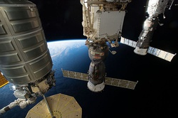 A Cygnus, Soyuz MS, and Progress MS spacecraft docked at the International Space Station