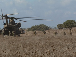 Israel Defense Forces Iron Trails Reconnaissance Company troops exit a CH-53 during an exercise