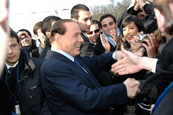 Berlusconi salutes the crowd on the EPP summit in 2009.