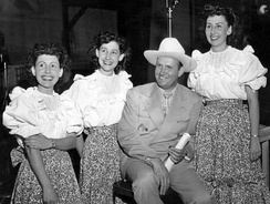 Gene Autry with the Pinafores, who sang on his weekly radio show, 1948