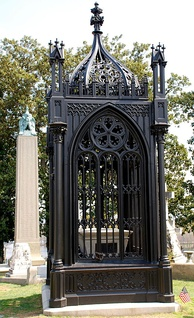 Monroe's grave at Hollywood Cemetery. John Tyler's grave is in the background.