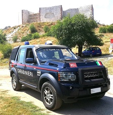 KFOR MSU patrol vehicle, in front of the fortress, checking the area to deter illegal activities on the site (2019).