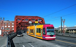 Car 021, the first production-series United Streetcar vehicle, crossing the Broadway Bridge on the CL Line.