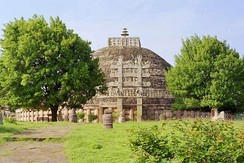 The stupa, which contained the relics of Buddha, at the center of the Sanchi complex was originally built by the Maurya Empire, but the balustrade around it is Sunga, and the decorative gateways are from the later Satavahana period.