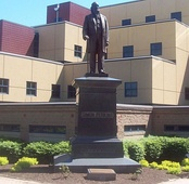 Statue of Simon Perkins, founder of Akron, in front of the University of Akron College of Business Administration, moved from its original location in Grace Park
