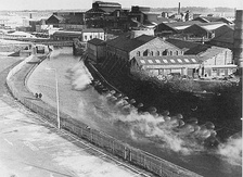 "Steam rises from ""The Hotties"" in St Helens town centre in the 1970s, water warmed by the Pilkingtons factory is pumped into the canal and is warm enough to support tropical fish making it a popular fishing site."