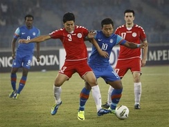 The Afghanistan national football team (in red uniforms) before its first win over India (in blue) during the 2011 SAFF Championship.