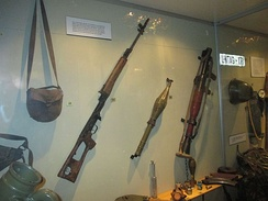 Equipment of Soviet origin supplied to SWAPO. From left to right: satchel, Dragunov sniper rifle, PG-7V RPG projectile, and RPG-7 launcher.