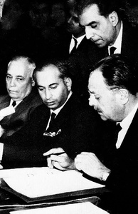 Signing of the Tashkent Declaration to end hostilities with India in 1965 in Tashkent, USSR, by President Ayub alongside Bhutto (centre) and Aziz Ahmed (left)