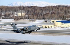 A C-17 Globemaster III takes off from Elmendorf Air Force Base on 26 March 2010