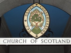 The Burning Bush emblem of the Church of Scotland, above the entrance to the Church Offices in Edinburgh