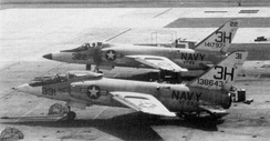 "An early production ""short nose"" F11F and a later ""long nose"" from VT-23"