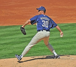 Maddux pitching for the Padres