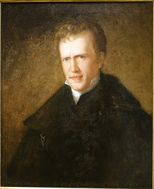 Color oil painting of the bust of a young white man with light brown short wavy hair and a plain countenance, looking at the viewer. The raised color of a white shirt is visible beneath a dark jacket and cloak. He stands before a plain brown-green background.