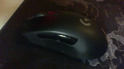 A Logitech G703 gaming mouse, with two buttons at the front and two buttons on the side