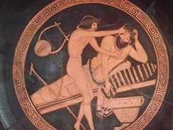 A drunk man vomiting, while a young slave is holding his forehead. Brygos Painter, 500–470 BC