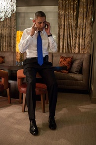 Obama takes a phone call from Romney conceding the election early Wednesday morning in Chicago.