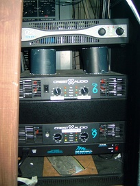 Three rack-mounted audio power amplifiers used in a sound reinforcement system.