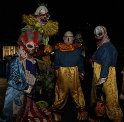 A group of people in evil clown costumes at a PDC 2008 party at Universal Studios