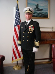 "A navy captain's ""Full Dress Blue Uniform"" with full-sized medals, white gloves and sword (2007)"