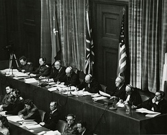 Judges sitting in Nuremberg, from left to right: Volchkov, Nikitchenko, Birkett, Sir Geoffrey Lawrence, Biddle, Parker, Donnedieu de Vabres and Falco